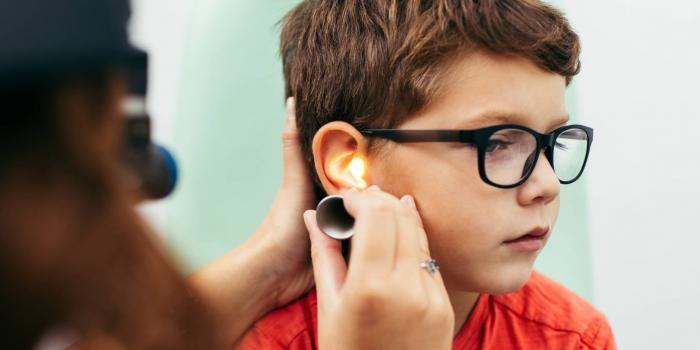 Boy getting ear exam