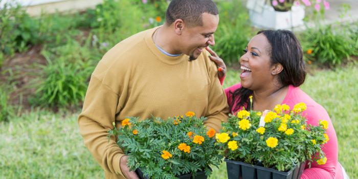 Couple holding flowers outside