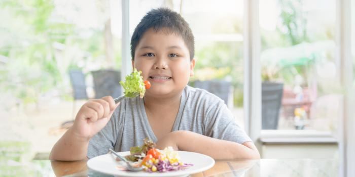 boy eating a salad