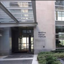 Exterior of building with windows and sign for McGlinn Cancer Institute