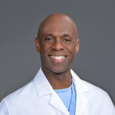 Dr. Lawton De Lisser